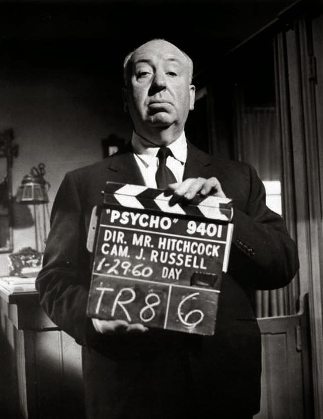 Alfred Hitchcock With The Clapper Board On The Set Behind the Scenes