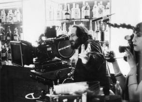 Stanley Kubrick films a shot on the set of The Shining