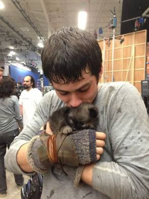 Dylan O'Brien with A Puppy on the Maze Runner Set