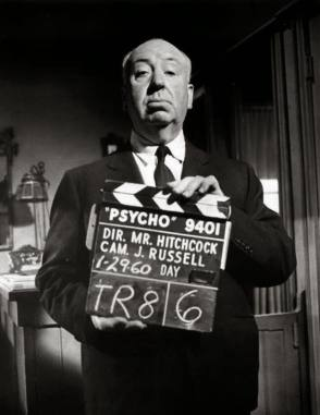 Alfred Hitchcock With The Clapper Board On The Set